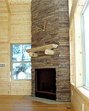 Stone fireplace, pine paneling, Douglas fir floors